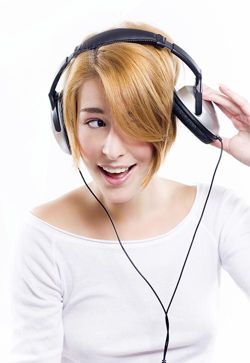 Woman enjoying her music.